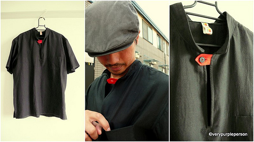 Black shirt with red button tab