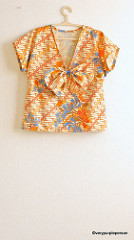 Batik top with bow brooch