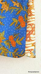 Batik top with bow brooch