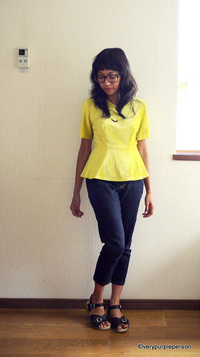 Peplum top and ankle-length jeans